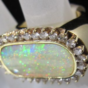 18 KT Yellow Gold 8-10 CT Opal Ring with 1 CT tw Diamonds