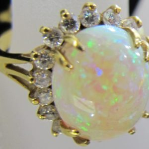 18 KT Yellow Gold 4.86 CT Opal Ring with .54 CT tw Diamonds