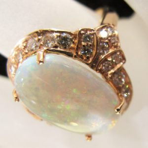 14 KT Rose Gold 8-10 CT Opal Ring with .60 CT tw Diamonds