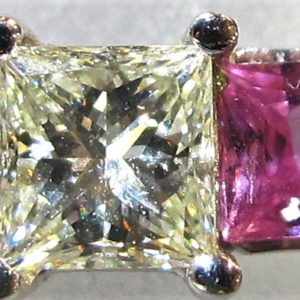 14 KT White Gold Ring with .73 CT Center Diamond and 2 Pink Sapphires tw .58 CT