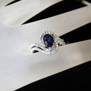 18 KT White Gold Ring with 1.04 CT Center Sapphire and .56 CT tw White Diamonds