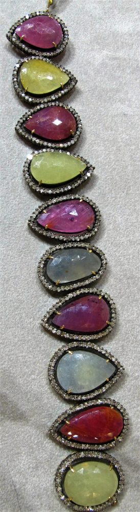14 KT Yellow Gold and Silver Bracelet with Rubies and Sapphires and 6 CT tw Diamonds
