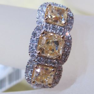 18 KT White Gold Ring with .52 CT tw Cushion Yellow Diamonds and .40 CT tw White Diamonds