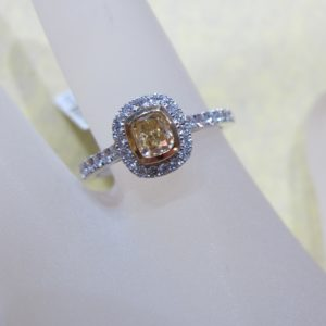 18 KT White Gold Ring Featuring a Center .63 CT Yellow Diamond and 2 Yellow .84 CT tw Diamonds and .54 CT tw White Diamonds