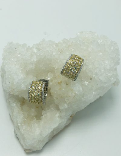 2.14 CT of Yellow Diamonds with a TW of 2.45 CT of Diamonds in 18 KT
