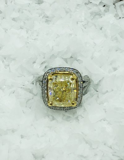 8.89 CT Fancy Yellow GIA Certified with 1.45 CT White Diamonds